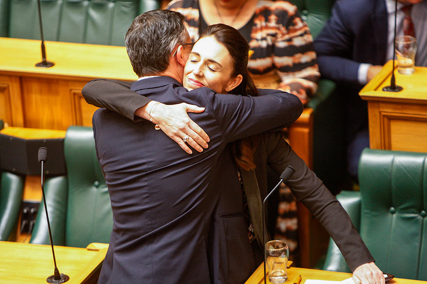 Text Box: Figure 5: New Zealand Prime Minister Jacinda Ardern embraces Climate Change Minister James Shaw in Parliament